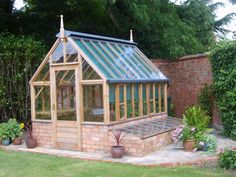 Should your garden have the space, then cold frames are a valuable addition to your greenhouse. They can be positioned down either side of the greenhouse, or both if you prefer. Cold frames are usuall Backyard Greenhouse, Greenhouse Growing, Greenhouse Plans, Greenhouse Wedding, Greenhouse Supplies, Plant Watering System, Patio Diy, Cedar Cladding, Pot Jardin