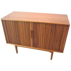 Danish Modern Teak Tambour Door Cabinet | From a unique collection of antique and modern cabinets at https://www.1stdibs.com/furniture/storage-case-pieces/cabinets/