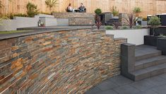 Stoneface Drystack Walling, Copper Slate. Coping is SYMPHONY, Dark paving cut to…