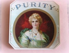 This is a vintage advertising label. It features a Victorian woman and the word Purity over her head. It is a embossed paper label and measures