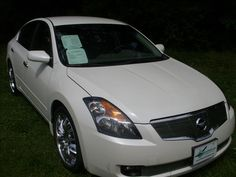2009 Nissan Altima 2.5 S, 56,771 miles.   Look at this Gorgeous Altima! The Diamond White paint really pops! Fully serviced, Carfax guaranteed, state inspected, full warranty, full tank of gas and free car wash's as long as you own it! Not another this clean or ready to drive with clean Carfax within 200 miles!