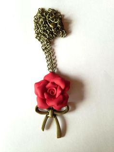 Polymer clay rose necklace with bow.