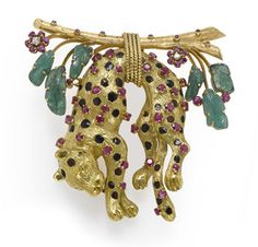 A ruby, emerald and enamel leopard brooch