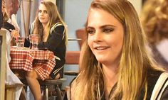 Cara Delevingne covers up as she dines al fresco in Cannes
