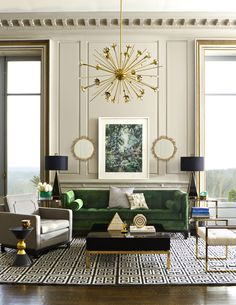 An emerald living room oasis complete with Jonathan Adler furniture, lighting, and decorative accessories.