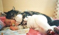 Awwww, I'm in love with this picture. Sweet Kitty and Baby <3