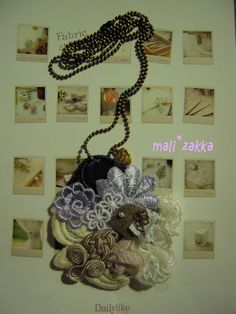 handmade necklace... little bird in fabric decorative blossom
