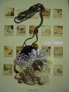 handmade necklace... little bird in fabric decorative blossom