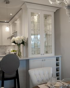 beautiful use of bar cabinetry. when we install i want in cabinet lighting like this