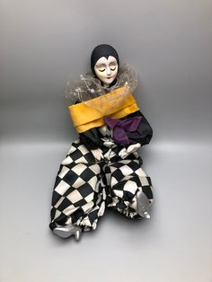 """15"""" Black and White Checkered Harlequin Jester Porcelain Posable Clown with Purple Ribbon and Silver and Orange Collar by Anaforia on Etsy Pierrot Clown, Purple Ribbon, Silver Shoes, Porcelain, African, Hand Painted, Black And White, Orange, Beautiful"""