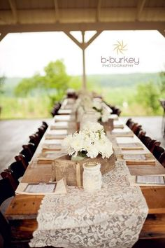 I love the burlap mats running the width of the table, with the lace runner going down the center length!  Beautiful!  :)