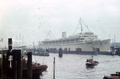 """Extremely rare color photo of the Wilhelm Gustolff in Hamburg, 1939. Fact: The Gustloff was actually the first """"purpose-built"""" European cruise ship! She was designed for the Nazi's Kraft durch Freude (Strength Through Joy) propaganda campaign to bridge the class divide, by making middle-class leisure activities available to the masses."""