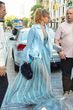 Mermaid moment! Gigi Hadid is a wonder as she slips into see-through turquoise gown embellished with fish scale details in NY | Daily Mail Online
