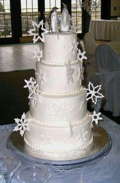 Gumpaste snowflakes on a buttercream iced wedding cake