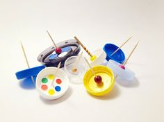 DIY Lollipop Spinning Tops for Kids - Made from Upcycled plastic bottle caps and a lollipop stick!