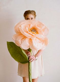 diy project: giant paper flowers from ruche | Design*Sponge. Love this idea for a girl's room or for arts and crafts room!