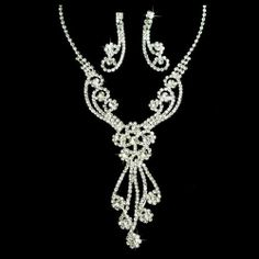 """Bridal Wedding Jewelry Set Crystal Rhinestones Gorgeous Dazzle Design Necklace Accessoriesforever. $35.00. Nickel / Lead Compliant. Color: Silver, Clear. Dimensions (Size): Necklace: 15"""" Long x 4"""" extension (Lobster Claw Closure), 3.25"""" Necklace Drop; Earrings: Approx. 1.75"""" Drop x 0.6"""" W (Post Back Closure). Style: Floral Design, Y-Drop Swirl. Material: Clear Crystal Rhinestones, Metal Casting, Rhodium / Silver Plated Wedding Jewelry Sets, Metal Casting, Clear Crystal, Crystal Rhinestone, Necklace Set, Floral Design, Crystals, Diamond, Purple"""