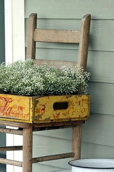 An old school chair and vintage wooden drinks crate bring a rustic touch to this outdoor space