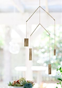 a favorite, this mobile featires two tiers which hangs perpendicular to each other and move independently | hand-cut and forged brass, this is the perfect home accessory for the modern or bohemian house #failjewelry #failHOME