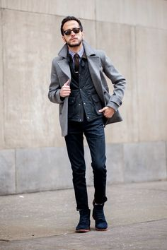 Shop this look for $354:  http://lookastic.com/men/looks/dress-shirt-and-tie-and-gilet-and-pea-coat-and-jeans-and-boots/1607  — Blue Gingham Dress Shirt  — Dark Brown Tie  — Navy Quilted Gilet  — Grey Pea Coat  — Navy Jeans  — Navy Suede Boots