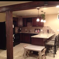 my mom would love this kitchen. she could save space with that breakfast bar. we can get her the appliances, the chairs she wants and dishes/cooking supplies she needs. it has to have natural light with windows that can open.