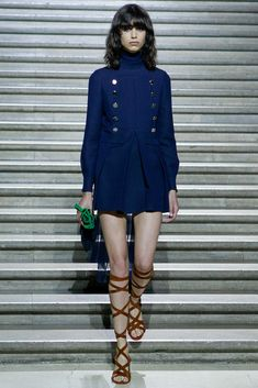 Late 60's perfection from Miu Miu Resort 15. Love the gladiator sandals and modern, disheveled hair.