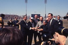 Pre-game ceremonies before the Expos first-ever home game on April 14, 1969. Montreal Mayor Jean Drapeau is wearing the Expos cap. To his left are MLB Commissioner Bowie Kuhn, Montreal City Counsellor Gerry Snyder, Quebec Premier Jean-Jacques Bertrand, and Expos President John McHale.