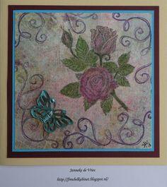 Op een vel canvas gestempeld.  Ingekleurd met Derwent Inktense potloden. De metalen vlinder met Inka Gold bewerkt.