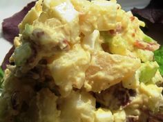 The Ultimate Comfort Food-Grandma's Potato Salad ~   1 Cup Hellman's mayonaise  1 Tbsp Vinegar  1 Tbsp mustard  1 1/2 tsp salt  1 tsp sugar  4 cups cooked, peeled, and sliced potatoes (5-7 potatoes)  1 cup diced celery  1/2 cup chopped onion  3 hard boiled eggs, sliced.  3-4 slices bacon, diced and browned  1/2 tsp celery seed.~  In large bowl stir together first 6 ingredients until smooth.  Add remaining ingredients.  Toss to coat well.  Cover; chill.  Makes about 5 cups.