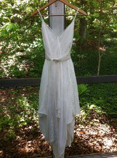 This dress is made from natural silk chiffon, with a flowing handkerchief hem, and vintage lace trim. Sash can be lace, silk satin, habotai silk or silk chiffon. Perfect for a 1920s/1930s style wedding, boho wedding, beach wedding. Lined. Pictured dress is white.  I use vintage laces, so lace will be slightly different from the lace in the photo. The waist is somewhat open and is adjustable, as the sash cinches in at the waistline.   If you decide to purchase this dress, please send me your…