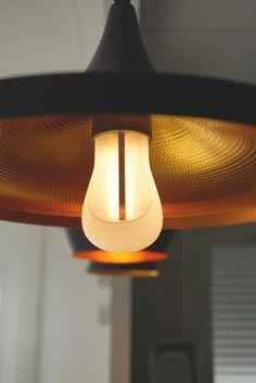 Ooh a Plumen 002 energy efficient designer light bulb in a Tom Dixon Beat Pendant!