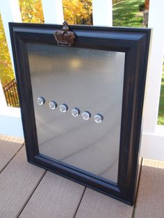 Framed Magnetic Magnet Bulletin Board / Makeup Cosmetic Display Organizer Wedding or Nursery Decor with Six Jewel Magnets. $34.00, via Etsy.