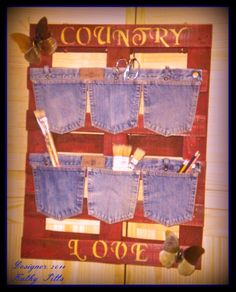 Old blue jean pockets & waist band on wooden pallet.