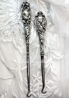 Antique Victorian Sterling Silver Button Hooks, both have ornate Art Nouveau Repousse Handles. Late 1800's