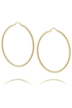 """Bold and dramatic, these 1970's inspired Carolina Bucci earrings have all the disco glam of their predecessors. Made modern by the subtly textured surface, these large 18K yellow gold hoops have just a hint of rocker sparkle. Pair with low slung jeans and a fringe jacket and you're ready to rock. Tone them down with a business suit for everyday edgy style.    Measures: 1 3/4"""" fastens with hook loop closure   Yellow Gold Hoops by Carrolina Bucci. Accessories - Jewelry - Earrings - Hoops…"""