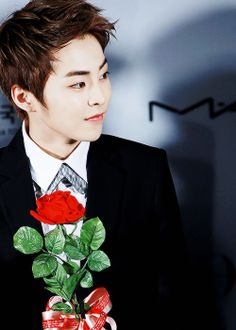 EXO Xiumin looking so charming holding that red rose. Can you please give it to me and be my boyfriend°° #minseok