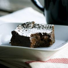 A rich mocha truffle layer and sprinkling of cinnamon and confectioners' sugar top these extraordinary brownies. Photo credit: Kaitlin Flannery of Whisk Kid