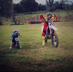Chad and Tate :) That kids gonna be fast. so adorable just like his Dad lov when this happens its so cute<3