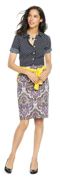 Like the pattern mixing -- navy spot blouse, navy/lilac/yellow/white damask skirt, yellow sweater