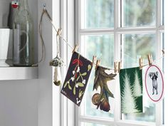 Twine and clothespins pair up for a charming, low-key display of holiday cards.   - CountryLiving.com