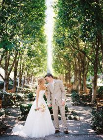 bride and groom, background lined with trees
