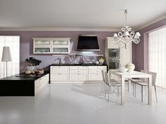 Decapé kitchen with handles PANTHEON | Wooden kitchen by Cucine ...