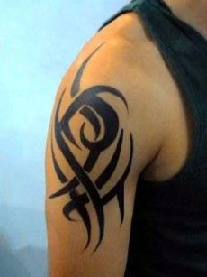A simple tribal tattoo design on man's right arm.