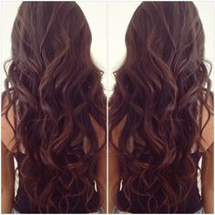 Chocolate brown curly hair.
