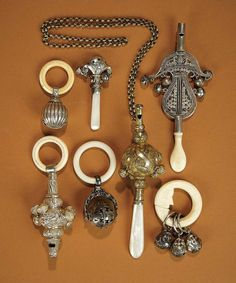 Collection of 19th century silver rattles. mother of pearl handles, bone rings, small bells, some have whistles