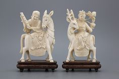The left one depicting Zhang Guo Lao, the immortal riding his donkey backwards, and the female immortal Magu on a deer. Size: 18 cm tall