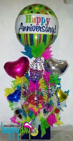 Arreglo para aniversario con globos y paleta.