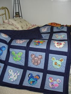 Mickey Quilt- I love that it's made with fabric from all the Disney movies! Would be the perfect quilt for when Joel and I have babies! I guess I better learn to quilt before then... :-) by lucile