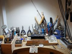 my kind of jewellers bench...ever so slightly cluttered and yet somehow organised.