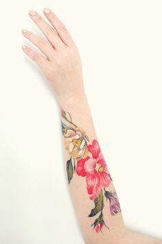 Gorgeous floral tattoo by Amanda Wachob